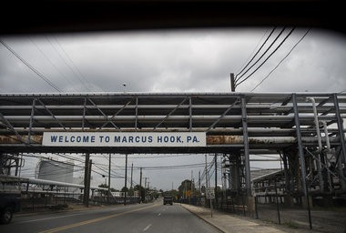 A welcome sign hangs across a road bracketed by the Sunoco Logistics Marcus Hook Industrial Complex. The borough of Marcus Hook in Delaware County is straddled by the Monroe Energy Trainer Refinery and the Sunoco Logistics Marcus Hook Industrial Complex, July 30, 2015. Dan Gleiter | dgleiter@pennlive.com