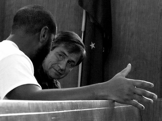 Joe Sestak speaking with a prisoner at State Correctional Institution Graterford in Montgomery County.