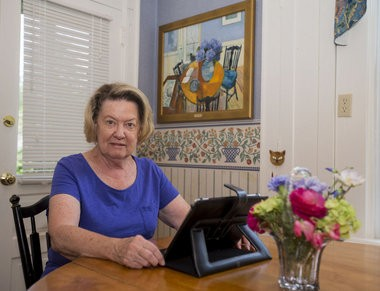 Susan Kelly-Dreiss founded the Pennsylvania Coalition Against Domestic Violence 30 years ago at this, her kitchen table, in Hershey, Pa., Aug. 16, 2016. The painting behind her commemorates that moment. Mark Pynes | mpynes@pennlive.com