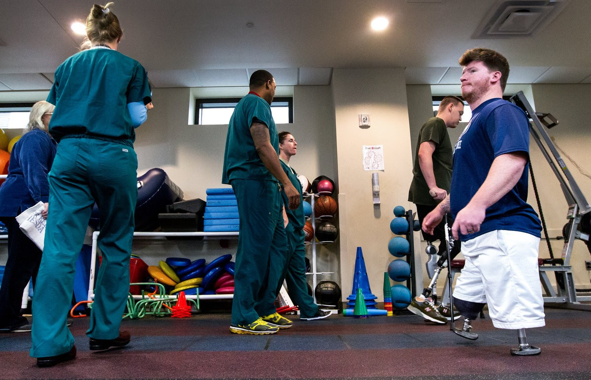 Rob Easley works with a pair of shorties during therapy at the Walter Reed National Military Medical Center, Bethesda, Maryland on Oct. 22, 2013.