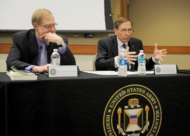 Gen. David Petraeus speaks, as Dr. Conrad Crane listens, during a roundtable discussion at the Army War College on Saturday afternoon.