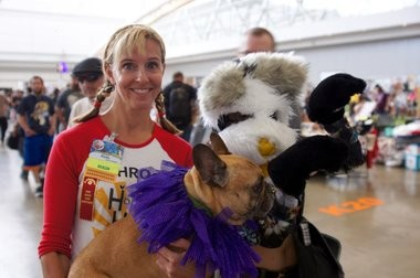 Karen Phillips of Hope Haven Farm Sanctuary, this year's Anthrocon charity, poses with her dog and a guest.