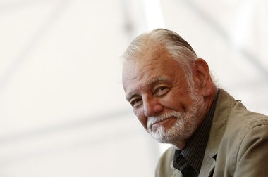 """George A. Romero poses during the photo call for the film """"Survival of the Dead"""" at the Venice Film Festival on Sept. 9, 2009."""