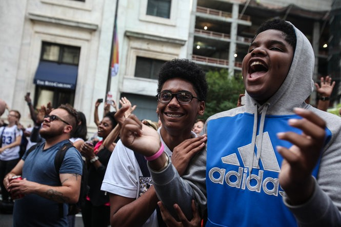 Science Leadership Academy Center City campus students Anthony Castro and Anthony Nelson cheer as the statue of Octavius V. Catto is revealed.