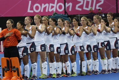 Northern Lebanon High School graduate Amy Swensen, left, stands with her teammates before the United States defeated Argentina 1-0 in its second field hockey game of the 2012 Olympics in London. Swensen announced her retirement from Team USA on Thursday.