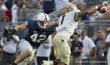 Penn State linebacker Michael Mauti pressures Navy quarterback Trey Miller on a 4th down during the third quarter at Beaver Stadium. Miller was called for grounding on the play. Penn State beat Navy, 34-7. JOE HERMITT, The Patriot-News