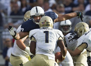 Penn State defensive lineman Jordan Hill moves in on Navy quarterback Trey Miller during the 3rd quarter at Beaver Stadium. Penn State beat Navy, 34-7.