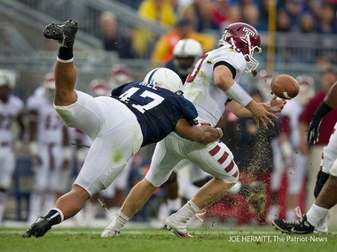 Penn State's Jordan Hill sacks Temple quarterback Chris Coyer and forces a fumble in the first half of the Nittany Lions' final non-conference game of the season.