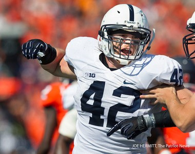 Penn State linebacker Michael Mauti celebrates a first-quarter tackle in the Nittany Lions' 35-7 win over Illinois at Memorial Stadium. JOE HERMITT, The Patriot-News