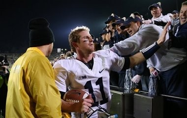 Penn State quarterback Matthew McGloin (11) greets fans as he leaves the field after their 38-14 victory over Iowa during an NCAA college football game at Kinnick Stadiumin Iowa City, Iowa, Saturday, Oct. 20, 2012. (AP Photo/Justin Hayworth)
