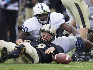Penn State defensive end Sean Stanley and Purdue quarterback Robert Marve watch as the ball squirts loose after Stanley sacked Marve during the second quarter at Ross-Ade Stadium. Marve recovered and Penn State beat Purdue, 34-9.