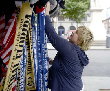Penn State alumna Rhonda Moscollic, from Pittsburgh, browses Nittany Lion themed scarves on O'Connell Street in Dublin, Ireland on Aug. 28, 2014.
