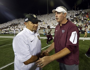 Army coach Jeff Monken, left, and Fordham coach Joe Moorhead shake hands after Fordham's 37-35 win in an NCAA college football game Friday, Sept. 4, 2015, in West Point, N.Y. (AP Photo/Mike Groll)