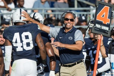 Penn State defensive end Shareef Miller (48) is congratulated by James Franklin as he comes off the field after a PSU stop.