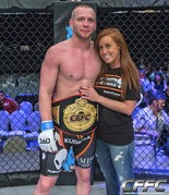 The Champ - Darrell and Daphney Horcher with the belt he won in the Cage Fury Fighting Championship Lightweight Title Fight in Atlantic City, N.J.