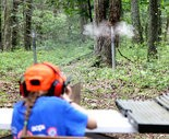 Bull's-eye - Vivian Cockley of Landisburg has an eye on the target at the Perry County Youth Field Day hosted at the Duncannon Sportsmen's Club. Cockley hit all three clays on the first try with a 20-gauge shotgun.