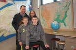 GLOBE-TROTTER -- Zach Byers (right), a seventh-grader at West Perry will compete in the state championship of the National Geographic Bee. With him (from left) are his father Mark, sister Jordan and mother Wendy.