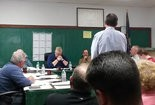ADVANCING - The Penn Twp. supervisors (front) listen to John Murphy of Alpha Consulting Engineers (standing) discuss aspects of the Stone Mill Estates plan on April 25. The supervisors approved the preliminary plan from Yingst Homes.