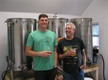 BUSY BREWERS -- Michael Lindgren (left) and father Clifford Lindgren have some fun sampling their beers at Lindgren Craft Brewery's location on the family farm in Penn Twp.