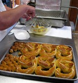 IN THE DOUGH -- Nancy Gavin, owner of Nancy's Soft Pretzels in Duncannon, finishes the first batch of pretzels for the day just before opening. She likes that there's been more business activity in recent years, but still thinks the borough is dealing with some challenges.