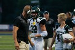 LISTEN UP -- Terrance Quaker, who scored five touchdowns in West Perry's win at Camp Hill, takes direction from Mustang offensive coordinator T.J. Quaker.