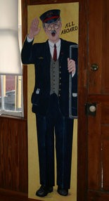 ALL ABOARD! -- A train conductor is one of the play props now residing at the historic train station in Blain, after spending years in storage in New Bloomfield.