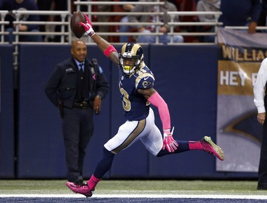 St. Louis Rams free safety Rodney McLeod celebrates as he heads into the end zone after recovering a fumble and running it back for a touchdown during the first quarter of an NFL football game against the Cleveland Browns Sunday, Oct. 25, 2015, in St. Louis. (AP Photo/Billy Hurst)