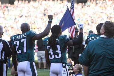 Eagles payers Jenkins and Brooks raise fists in protest during the National  Anthem. The Pittsburgh 1a7b8b40c