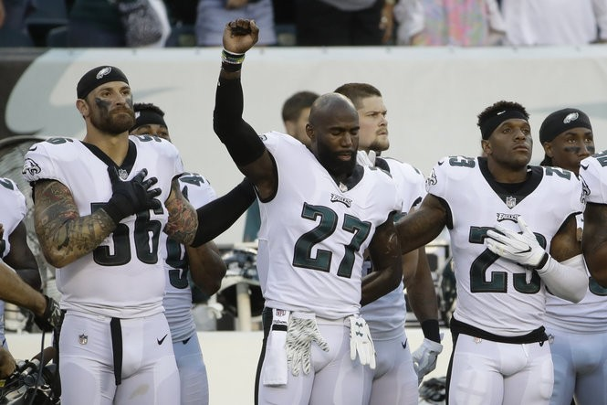 Philadelphia Eagles' Chris Long, from left, Malcolm Jenkins and Rodney McLeod stand on the sidelines during the playing of the National Anthem before a preseason NFL football game against the Miami Dolphins, Thursday, Aug. 24, 2017, in Philadelphia.
