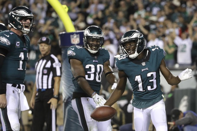 8ae6b5233ce Philadelphia Eagles wide receiver Nelson Agholor (13) celebrates with Corey  Clement (30) and Carson Wentz (11) after he caught a touchdown pass from  Wentz ...