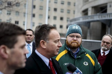 Corbett-appointed Office of Open Records executive director Erik Arneson (in green jacket) filed a lawsuit on Monday challenging his firing by Gov. Tom Wolf.