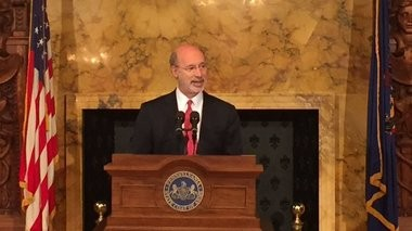 Gov. Tom Wolf signed a $23.4 billion emergency funding plan on Tuesday, allowing the state to begin paying back bills it owes to school districts, counties, veterans, among others.