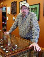 Chris Hughes, owner of the Fat Cat Vapor Shop.