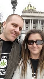 Jeff Zick, with his wife Mandy, in front of the state Capitol.