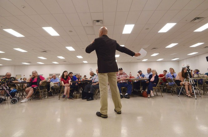In this May 3, 2018, photo, Doug Mastriano, one of eight Republicans running for the U.S. House in Pennsylvania's 13th District, speaks to a crowd of party faithful at the Southeastern Adams Volunteer Emergency Services social hall, in Hanover, Pa. (AP Photo/Marc Levy)