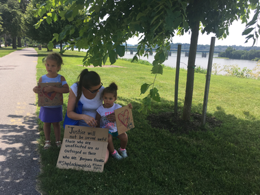 Kelly Smith, along with her daughters 2-year-old Lilah and 4-year-old Gracelin, participated in the immigration rally to speak up for the immigrant children who have been separated from their families.