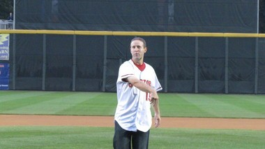 Brian Jeroloman throws out the ceremonial first pitch before the Harrisburg Senators' final playoff game Sept. 12, 2013. You can see a dark scar on his neck where he suffered a gash.