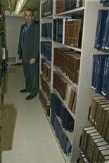 Pennsylvania state trooper Kent Bernier visits the stacks of what is now Penn State's Pattee/Paterno Library, where a body was found decades ago.