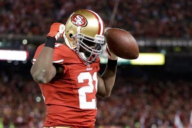 58d179604 San Francisco 49ers running back Frank Gore (21) celebrates after running  for a touchdown
