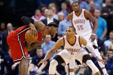 be9fc7102c9 Miami Heat forward LeBron James, left, keeps the ball from Oklahoma City  Thunder guard