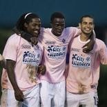 Lucky Mkosana (left), Sainey Touray (center) and Morgan Langley (right), shown celebrating last season, will play important roles in the Harrisburg City Islanders' attacking third.