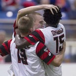 Tom Mellor (center) celebrates one of his 18 goals last season with then-teammates Andrew Marshall and Brian Ombiji.