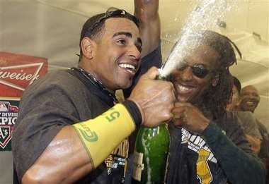 Yoenis Cespedes sprays champagne in 2012 as Athletics celebrate first of two straight AL West titles.