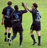 Brett Wiesner is congratulated by former Harrisburg City Islanders teammates Almir Barbosa (center) and Adam Clay (left) after scoring a goal in the Lamar Hunt U.S. Open Cup against the Yakima Reds. Wiesner died early Saturday at the age of 31.