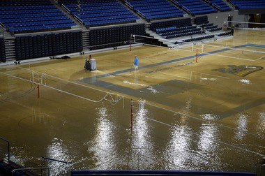 At least an inch of water covers the playing floor at Pauley Pavilion, home of UCLA basketball, after a broken 30-inch water main under nearby Sunset Boulevard caused flooding that inundated several areas of the UCLA campus in the Westwood section of Los Angeles Tuesday, July 29, 2014. (AP Photo/Mike Meadows)