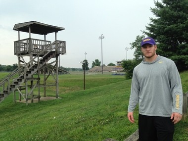Connor will soon be helping to run his first training camp as a coach before West Chester's opener at Farrell Stadium (background).