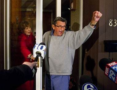 """Penn State coach Joe Paterno and his wife Sue on the front porch of their house, addressing students. The students yelled """"We Are Penn State"""" and Paterno responded, """"Yes we are!"""" Penn State University Board of Trustees fired Paterno that day over the Jerry Sandusky sex abuse scandal. November 10, 2011."""