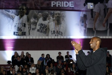 Los Angles Lakers basketball player Kobe Bryant applauds during a dedication ceremony for a new gymnasium at Lower Merion High School, Thursday, Dec. 16, 2010, in Ardmore, Pa. The gym was named and dedicated to Bryant, a Lower Merion alumnus. (AP Photo/Matt Slocum)