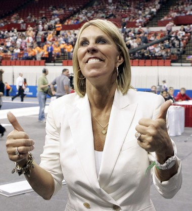 Georgia coach Suzanne Yoculan gives the thumbs up to Georgia fans at the team finals of the NCAA gymnastics championships in Lincoln, Neb., Friday, April 17, 2009.(AP Photo/Nati Harnik)