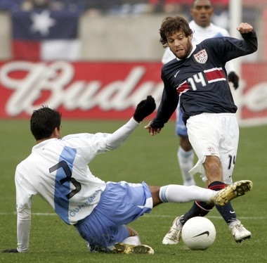 Middletown native Ben Olsen (14), shown here with the U.S. national team against Guatemala in 2006, was decidedly the best soccer prospect to come out of Dauphin County before Pulisic.